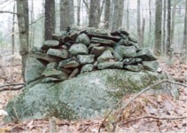 Cairn - Mound of stones on top of boulder